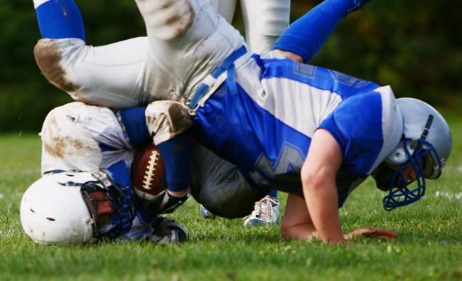 hard football tackles can cause concussions